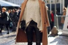 a neutral chunky knit sweater, black cropped leather pants, black booties, a camel coat and a black bag