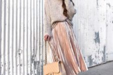 a neutral oversized sweater, a blush pleated midi skirt, blush heels and a neutral bag
