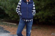 a plaid shirt, a navy puffer vest, navy boyfriends, warm winter boots and a white beanie