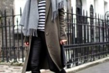 a striped top, black cropped leather pants, a grene coat, a grey scarf and trainers