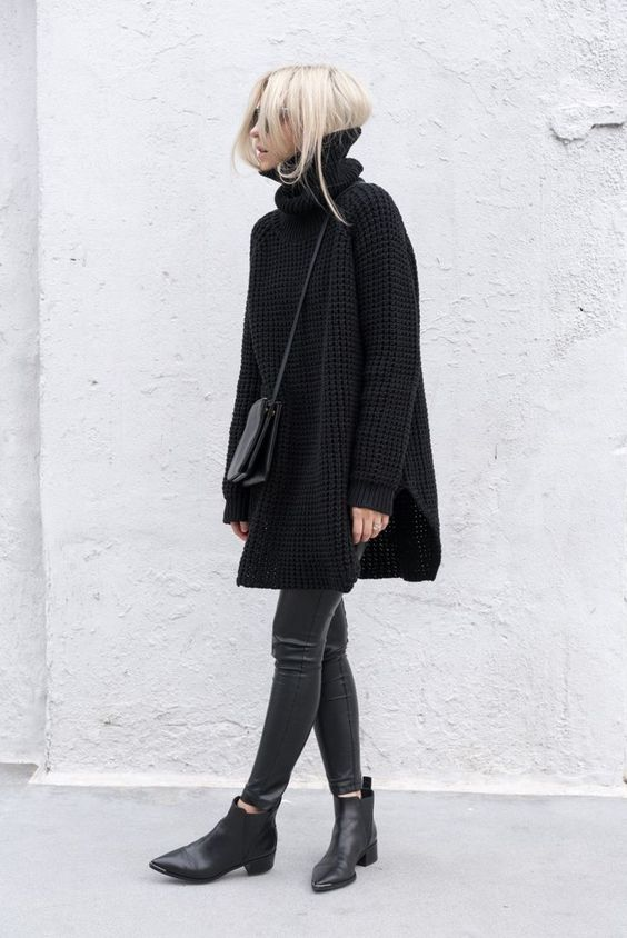 an oversized black turtleneck sweater, black cropped pants, black chelsea boots and a bag
