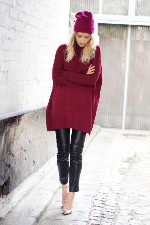 black cropped culottes, a fuchsia oversized sweater, snake print shoes and a pink beanie