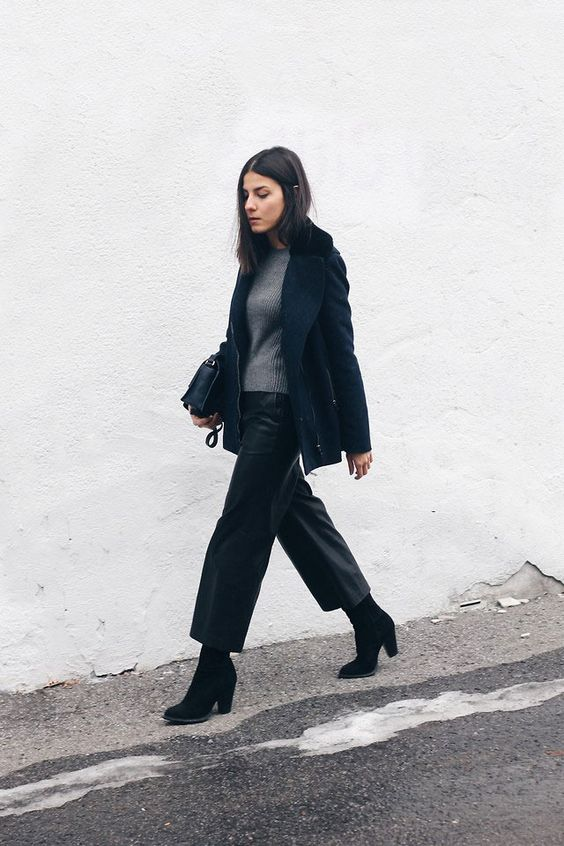 black cropped leather pants, a grey sweater, a navy short coat, black booties and a bag