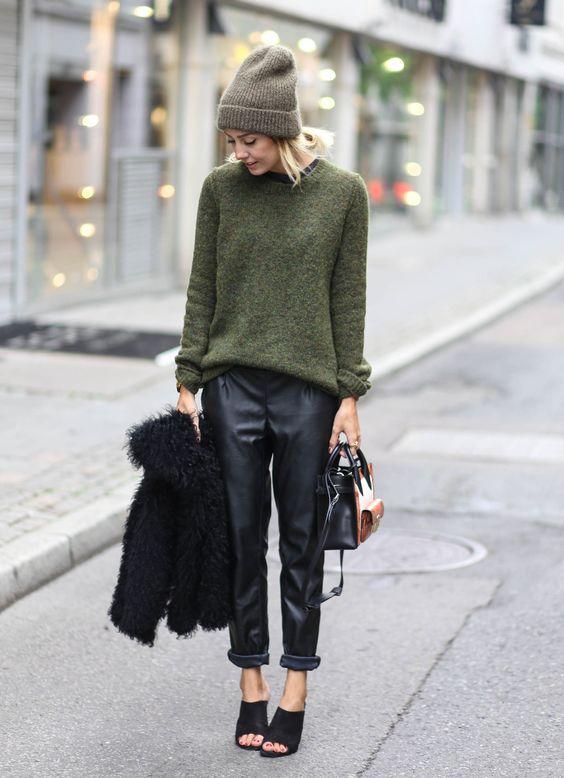 black cropped pants, a green sweater, a grey beanie, black peep toe shoes and a black teddy bear coat