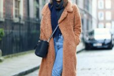 blue cropped jeans, a navy scarf, burgundy boots, a camel teddy bear coat and a beanie