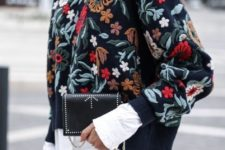 16 blue skinnies, a white shirt, a floral embroidered sweatshirt and a clutch, just add a coat