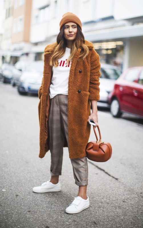 plaid cropped pants, a white sweatshirt, white sneakers, a mustard teddy bear coat, a brown bag and beanie