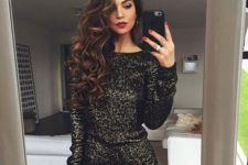 02 a black sequin romper with long sleeves and a touch of gold and shoes are all you need for New Year's Eve
