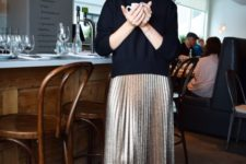 02 a black turtleneck, a metallic pleated midi skirt, black shoes with glitter touches