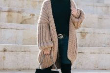 02 a black turtleneck, navy skinnies, tall black boots, a chunky knit long cardigan and a stylish bag