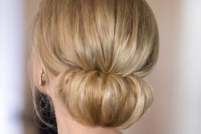 02 a cute low chignon hairstyle with a bump is a very elegant and chic hair idea for holidays