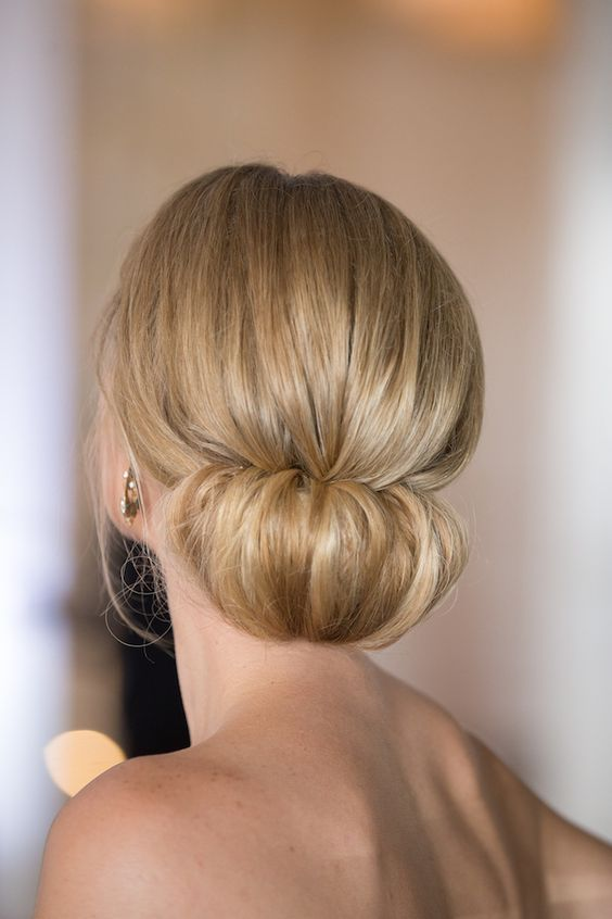 a cute low chignon hairstyle with a bump is a very elegant and chic hair idea for holidays