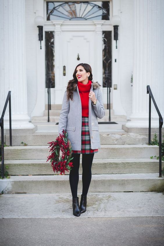 a plaid mini, a red oversized sweater, a grey coat with faux fur, black booties for holidays