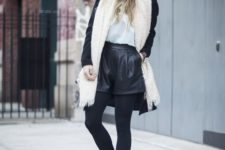 02 black tights, booties, leather shorts, a printed tee, a black coat, a creamy fluffy scarf and a grey beanie
