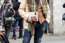02 navy jeans, a blue shirt, a striped tie, a brown waistcoat, brown shoes, a camel short coat and a hat