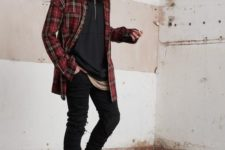 03 a black hoodie, black jeans, tall tan boots, a plaid red shirt for a layered and relaxed winter look