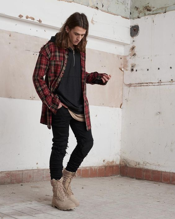 a black hoodie, black jeans, tall tan boots, a plaid red shirt for a layered and relaxed winter look