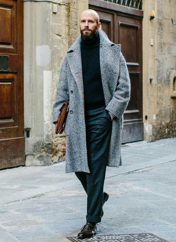a casual office look with grey pants, a black turtleneck, a grey printed overcoat, black shoes