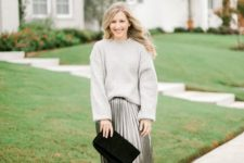 03 a grey cashmere oversized sweater, a grey pleated metallic midi skirt, white sneakers and a black suede clutch