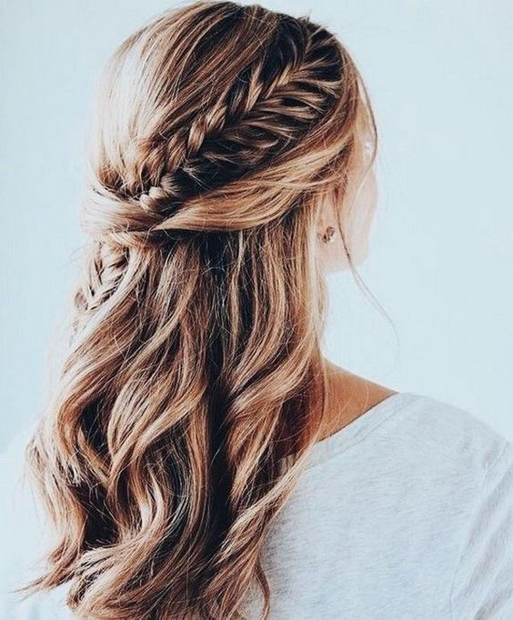 a half updo with waves and a single side braid tucked into the twists is a chic idea