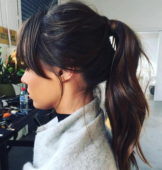 a high messy ponytail with bangs and a messy bump is a cool idea, make your tail wavy