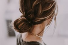 03 a low bun with a large sided braid is a comfy and long-lasting hairstyle with a casual feel