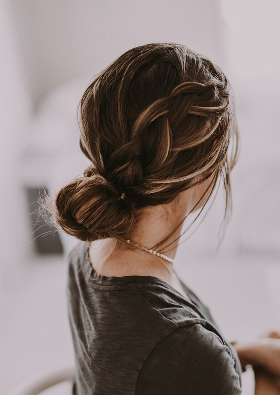 a low bun with a large sided braid is a comfy and long lasting hairstyle with a casual feel