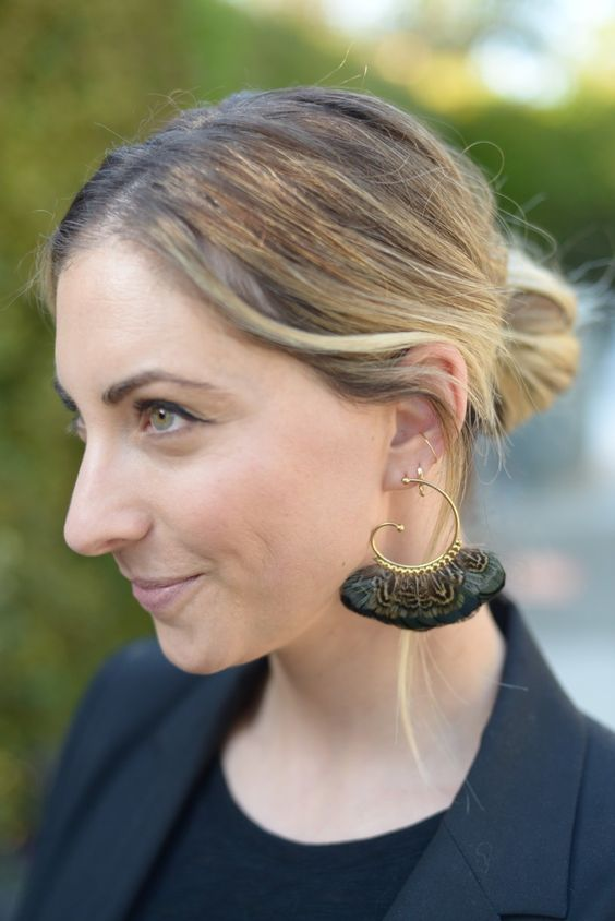 a messy low chignon is easy to recreate any time and statement earrings will add a festive feel