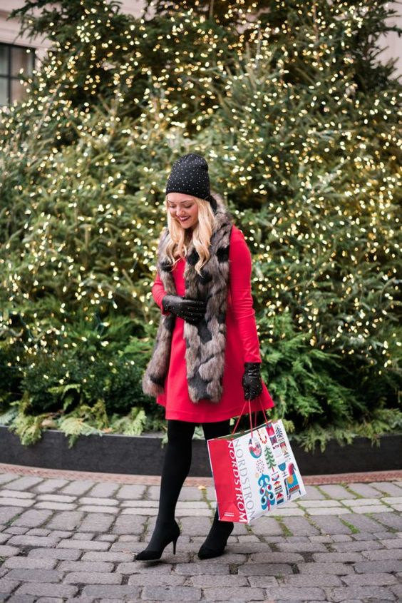 a red knee dress, black tights, black velvet heels, a faux fur scarf and a polka dot beanie plus gloves