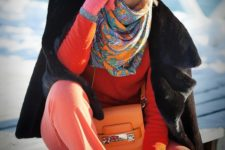 03 coral pants, an orange sweater, a black fur capelet, black sneakers and a fur hat, a printed scarf and pink gloves