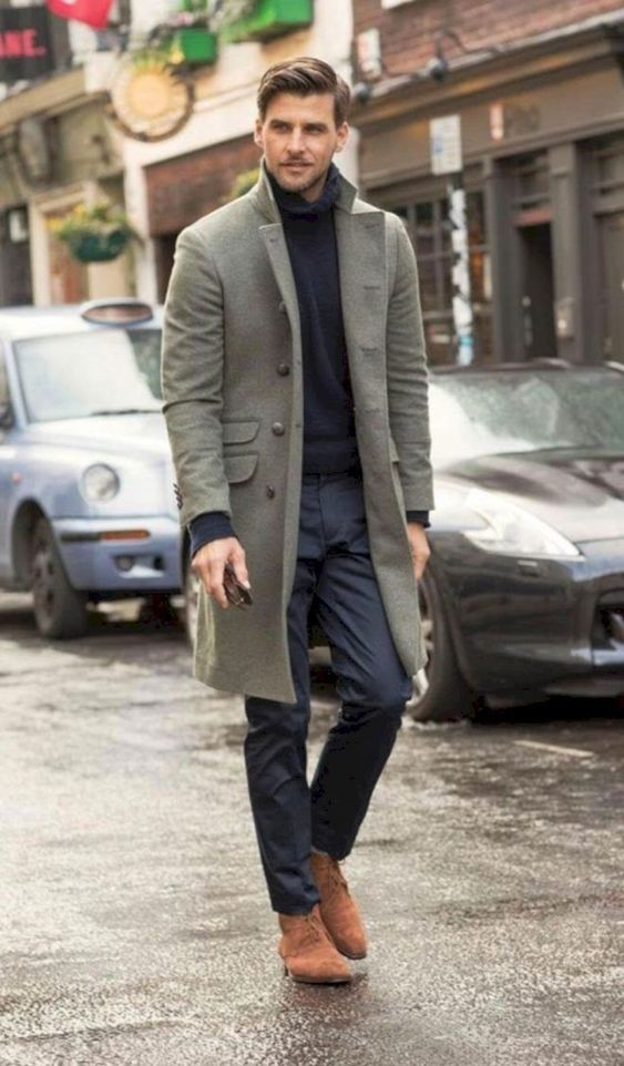 a black turtleneck, navy pants, rust shoes and a grey overcoat that makes this casual look a bit more formal