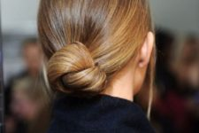 04 a low knot bun with a sleek top can be worn throughout the day and at a party too