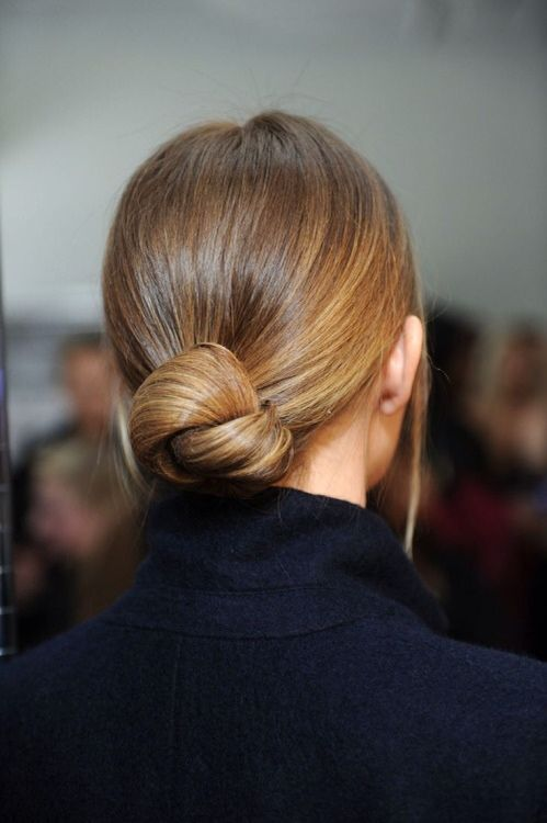 a low knot bun with a sleek top can be worn throughout the day and at a party too