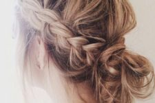 04 a messy low bun with two side braids is an effortlessly chic option for Christmas parties