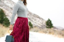 04 a plum-colored pleated velvet midi skirt, a grewy sweater with a sequined high neckline, grey shoes and a small bag