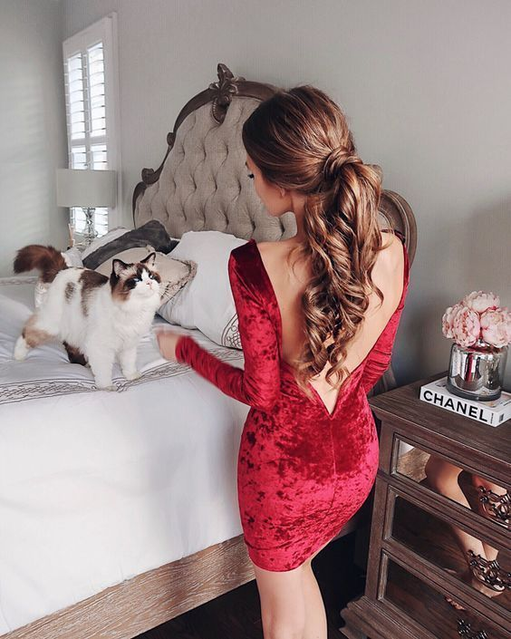 a red velvet knee dress with a cutout back and long sleeves is all you need to make a sexy statement