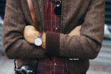 04 a vintage-inspired look with navy jeans, a red plaid shirt, a brown bomber jacket and a vintage camera