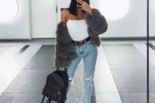 04 blue ripped denim, white sneakers, a whiet top and a grey cropped fur coat plus a backpack