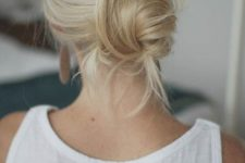 05 a quick and easy messy updo with a messy bump and bangs is a chic and effortless idea