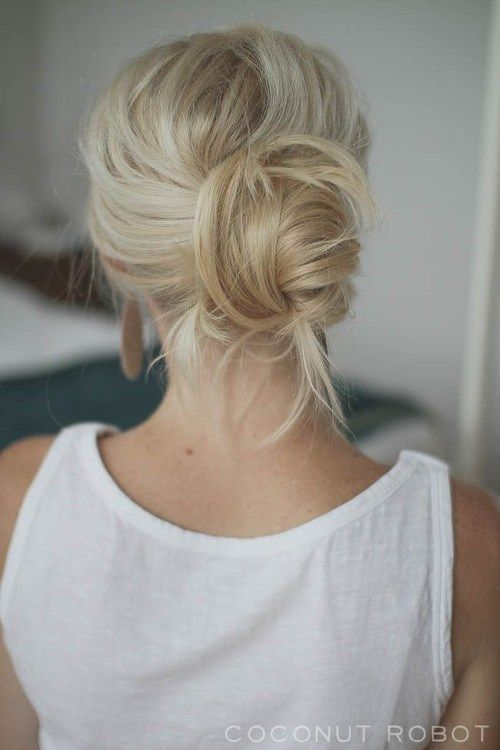 a quick and easy messy updo with a messy bump and bangs is a chic and effortless idea