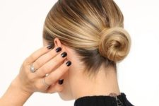 a sleek low bun with a sleek top always works and matches many kinds of outfits