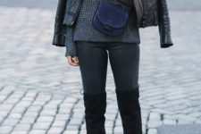05 black skinnies, black tall boots, a grey textured sweater, a black leather jacket and a navy bag