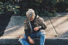 05 blue ripped jeans, a green hoodie, a plaid shirt, tall tan boots create a relaxed winter outfit
