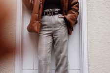 05 plaid cropped pants, a black turtleneck, leopard flats and a rust puffer jacket for a trendy feel