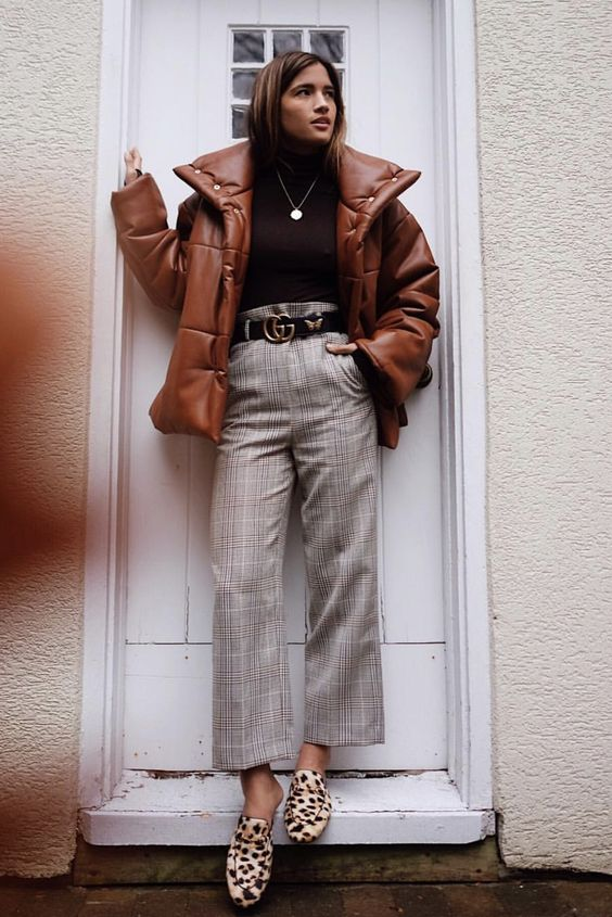 plaid cropped pants, a black turtleneck, leopard flats and a rust puffer jacket for a trendy feel