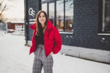06 a black sweater, high waist grey plaid pants, black boots and a red puffer jacket