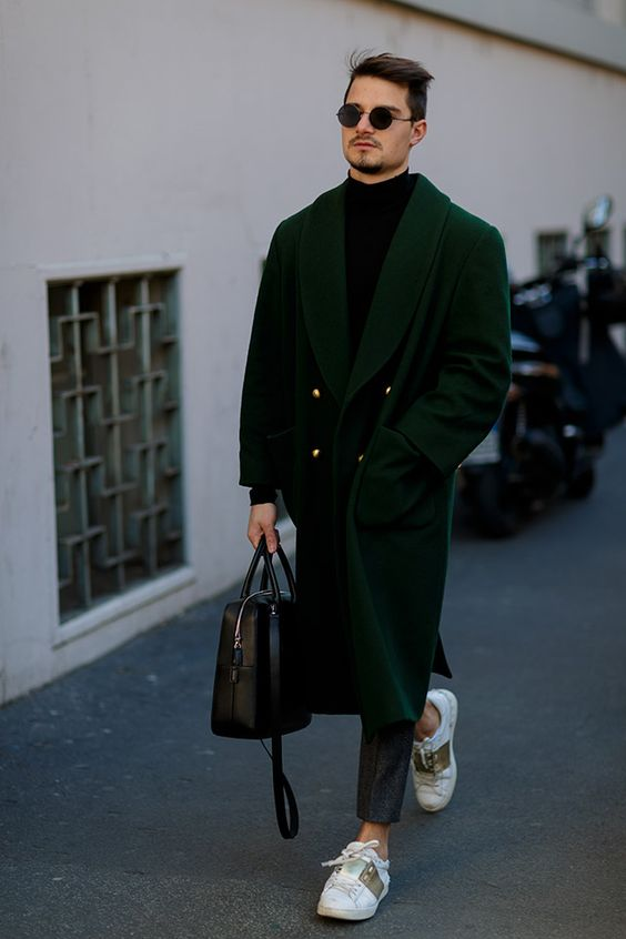 a black turtleneck, grey cropped pants, an emerald overcoat and white sneakers for a smart casual outfit