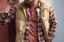 06 a layered casual look with a tree, a plaid shirt, a tan puffer vest and blue jeans for fall or winter