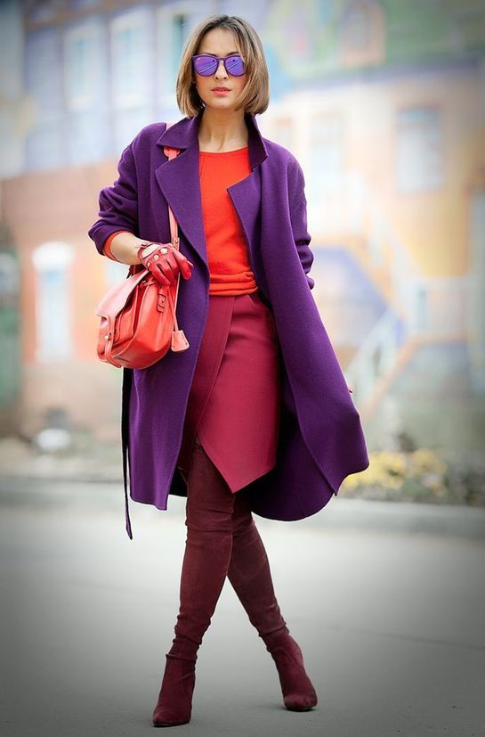 plum-colored tall boots, a fuchsia wrap skirt, a coral sweater, a purple midi coat and a coral bag