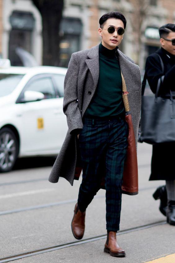 a dark green turtleneck, green plaid pants, brown chelsea boots and a grey overcoat